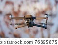 Drone flying outdoors 76895875
