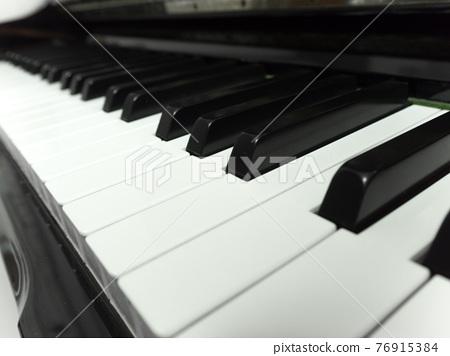 Piano keyboard close-up 76915384