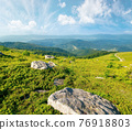 summer mountain landscape with stones on the hill. wonderful view in to the distant valley on a sunny morning. fluffy clouds above horizon 76918803