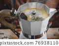 Coffee making with Moka pot and snack. 76938110