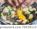 Hot soup vegetables and meats shabu style. 76938113