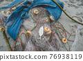 Fishing net on the beach. 76938119