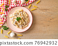 penne pasta carbonara cream sauce with mushroom 76942932