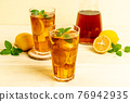glass of ice lemon tea 76942935