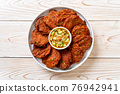 fried fish paste balls or deep fried fish cake 76942941