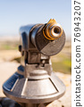 Old fashioned telescope in Mdina. Touristic spyglass allows to observe surrounding area for small fee. Antique optical device for tourists. 76943207