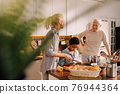 Family and cute little son cooking in modern kitchen together 76944364