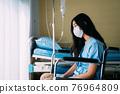 Depressed patient sitting on wheelchair 76964809