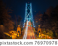 Lions Gate Bridge at night. Cars driving on the bridge with long exposure. Stanley Park, Vancouver, British Colombia, Canada. 76970978