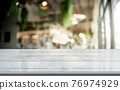 Empty wood table on blur restaurant background. 76974929