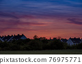 Houses and trees at sunset 76975771