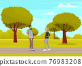 Couple in relationship walking in park. Guy meets girl holding bouquet of flowers behind his back 76983208