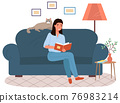 Young woman is sitting on couch and reading book. Female pet owner with literature at home 76983214