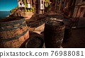 old wooden wine barrels in a sea town port 76988081
