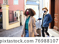 Young couple tourists with luggage leaving house for holiday, coronavirus concept. 76988107