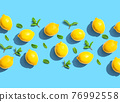 Fresh yellow lemons with mints overhead view 76992558