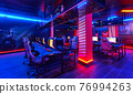 Inside of modern internet cybercafe, no people 76994263