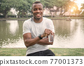portrait Male athlete smiling and happy 77001373