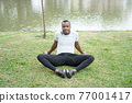 Young man exercise and listen music in park. 77001417