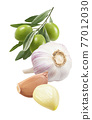 Green olives, garlic bulb and cloves isolated on white background. Vertical layout. 77012030