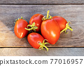 Fresh red tomatoes on vintage wooden table, selective focus 77016957