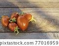 Fresh red tomatoes on vintage wooden table, selective focus 77016959