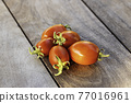Fresh red tomatoes on vintage wooden table, selective focus 77016961