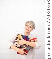 Senior asian woman holding mount of gift boxes, enjoying many best presents. 77030563