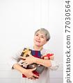 Senior asian woman holding mount of gift boxes, enjoying many best presents. 77030564