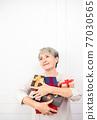 Senior asian woman holding mount of gift boxes, enjoying many best presents. 77030565
