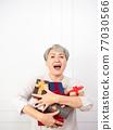 Senior asian woman holding mount of gift boxes, enjoying many best presents. 77030566