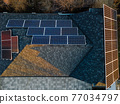 Aerial view of solar photovoltaic panels on a house roof 77034797