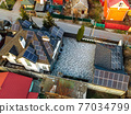 Aerial view of solar photovoltaic panels on a house roof 77034799