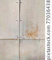 Corroded metal background. Rusty metal background with streaks of rust. Rust stains. Rystycorrosion. 77036438
