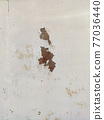 Corroded metal background. Rusty metal background with streaks of rust. Rust stains. Rystycorrosion. 77036440
