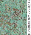 Rusty metal background with streaks of rust. Corroded metal background. Rust stains. Rystycorrosion. 77036441