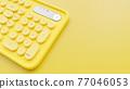 Yellow pastel keyboard. 77046053