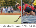 Field hockey player waiting for the penalty shot 77052436
