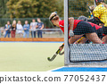 Field hockey player waiting for the penalty shot 77052437