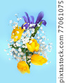 Beautiful bouquet of yellow tulips, iris and baby's-breath on blue background. 77061075