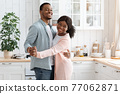 Affectionate Black Spouses Having Fun At Home, Dancing In Kitchen 77062871
