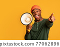 Cheerful Black Guy Shouting In Loudspeaker And Pointing At Camera 77062896