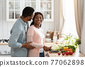 Romantic African American Couple Cooking Healthy Lunch At Home 77062898