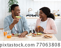 Domestic Morning. Romantic Black Man And Woman Eating Breakfast In Kitchen 77063808