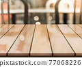 Empty wooden table top with lights bokeh on blur restaurant background. 77068226