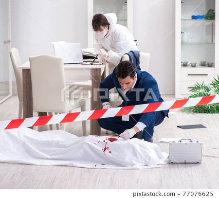 Forensics investigator at the scene of office crime 77076625