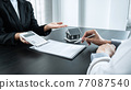 Estate agent broker presentating to client decision signing agreement contract real estate with approved mortgage application, buying mortgage loan offer for and house insurance 77087540