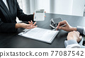 Estate agent broker presentating to client decision signing agreement contract real estate with approved mortgage application, buying mortgage loan offer for and house insurance 77087542