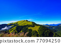 Beautiful views of the mountains, blue sky, white clouds and fresh air. The scenery along the Central Cross-island Highway in Taiwan. December 2020. 77094250