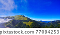 Beautiful views of the mountains, blue sky, white clouds and fresh air. The scenery along the Central Cross-island Highway in Taiwan. December 2020. 77094253